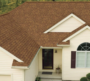A brown shingle residential roofing system is shown from above
